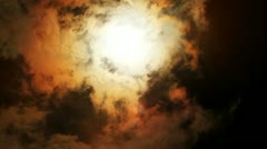 Sun behind dark cloud Stock Footage