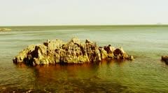 Ocean water surface and rock reef coastal,algae,seaweed,ebb,gravel,island. Stock Footage