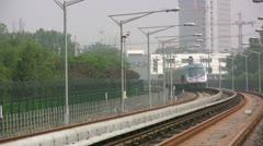 Subway train, arrival, public transportation, metro, Beijing, China Stock Footage
