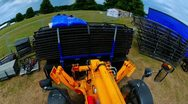 Stock Video Footage of Fast time lapse footage of a JCB digger moving equipment.