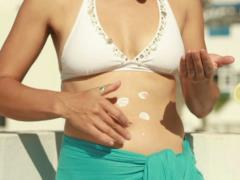 Woman applying sun block lotion on her body, steadicam shot Stock Footage