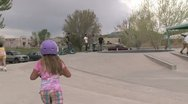 Editorial: Young Girl Riding a Scooter at Park Stock Footage