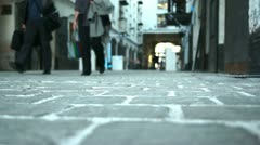 People walking on cobblestones  (soft focus) - stock footage