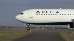 Taxiing Delta Airlines plane - stock footage