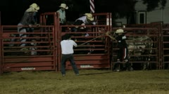 Stock Footage - Bull rider thrown to the ground hard - injured Stock Footage