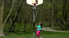 Young Girl Practicing Basketball Stock Footage