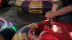 Stock Footage - Children in bumper Cars - Lights - Close - Color. Stock Footage