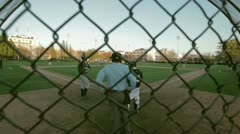 Baseball from behind the umpire handheld Stock Footage