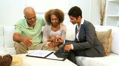 Female Business Advisor Home Meeting Elderly Couple Stock Footage