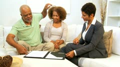 Female Financial Expert Home Meeting Senior Couple - stock footage