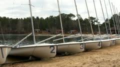 420 fleet lined up on beach Stock Footage