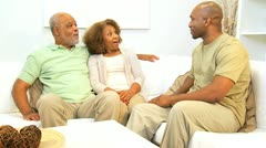 Senior Ethnic Couple with Adult Son Home - stock footage