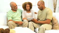 African American Son and Parents Wireless Tablet Technology - stock footage