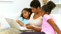 Stock Video Footage of African American Mother Girls Online Shopping