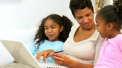 Ethnic Mother and Daughters Online Credit Card Shopping Stock Footage