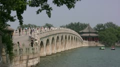Traditional bridge and pagoda in the Summer Palace in Beijing, China Stock Footage