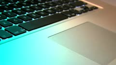 Low angle track over computer keyboard Stock Footage