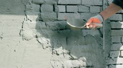 Applying Plaster To A Brick Wall Stock Footage