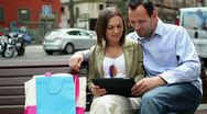 Young couple using electronic tablet in the city HD Stock Footage