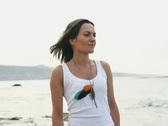 Happy woman standing on the seashore, steadicam shot NTSC Stock Footage