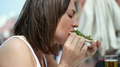 Young woman eating lunch at outdoor restaurant HD Stock Footage