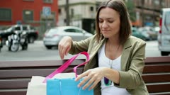 Beautiful woman looking at her purchases after shopping HD Stock Footage