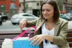 Beautiful woman looking at her purchases after shopping NTSC Stock Footage