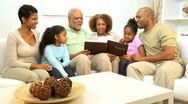 Stock Video Footage of Three Generations African American Enjoying Photo Album