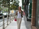 Stock Video Footage of Smiling woman with shopping bags walking in the city, slow motion NTSC
