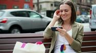 Stock Video Footage of Young woman using smartphone in the city HD