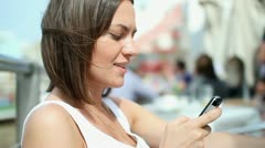 Young woman sending sms, texting outdoor, close up HD - stock footage