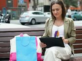 Stock Video Footage of Young woman using electronic tablet in the city NTSC