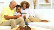 African American Grandparents Grandchild Wireless Tablet Apps  Stock Footage