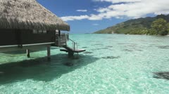 Stock Video Footage of Over water bungalow with steps into amazing lagoon