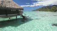 Over water bungalow with steps into amazing lagoon Stock Footage