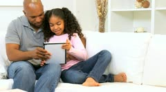 Ethnic Father Daughter Home Touch Screen Tablet  Stock Footage