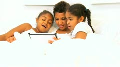 African American Mom Girls Bed Wireless Tablet   Stock Footage