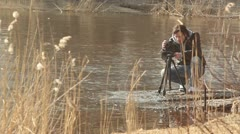 Photographer shooting nature on tripod Stock Footage