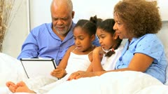 Ethnic Grandparents Grandchildren Bedroom Wireless Tablet  Stock Footage