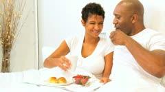 Ethnic Couple Sharing Breakfast Bedroom  Stock Footage