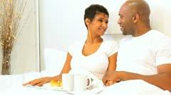 Ethnic Couple Enjoying Breakfast Bedroom  - stock footage