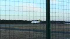 Plane taking off on airport runway Stock Footage
