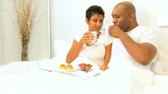 African American Couple Weekend Breakfast Bed   Stock Footage