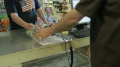 Stock Footage - Teen making a purchase at a store - Full transaction - stock footage