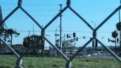 Cranes pan l-r with metalic fence Stock Footage