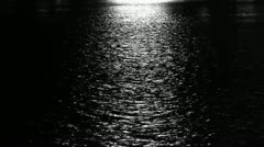 Water ripples reflection at night. - stock footage