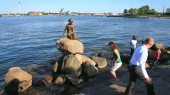Tourists flock around The Little Mermaid Statue, Denmark GFHD Stock Footage