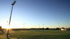 Stock Video Footage of Randburg Sports Field at Sunset with Dog GFHD