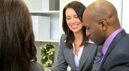 Stock Video Footage of Multi Ethnic Business Team Modern Boardroom
