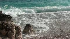 Sea waves washing pebble beach Stock Footage